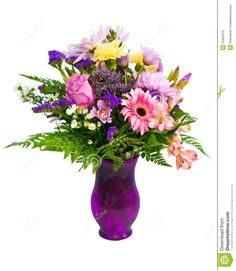 colorful flowers in vases   Colorful flower bouquet arrangement in vase isolated on white.
