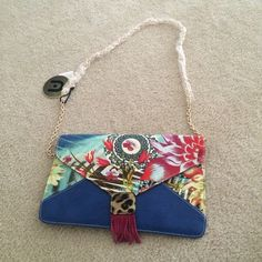 Nila Anthony Clutch & Crossbody Bag Beautiful name brand bag that has never been used before. I can fit an iPad mini in this! Inside has one zip pocket on first side, two pockets on the other. PLUS a detachable chain so you can go from crossbody to clutch and back with ease. Beautiful statement accessory, popping with lots of color + great quality too! Nila Anthony Bags Clutches & Wristlets