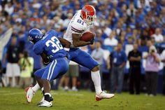 465d3cef2 Sep 2009 NCAA Football  Florida at Kentucky Florida Gators wide receiver  Aaron Hernandez runs for a touchdown past Kentucky Wildcats linebacker  Trevard ...