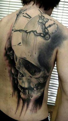 Back skull clock tattoo