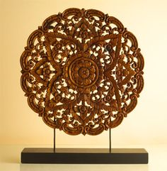 Circular Carved Plaque--A tour de force of hand carving, this intricate design is the work of Thai artisans, who transform indigenous acacia wood into many stunning motifs. Ready for prominent display in your home or office.