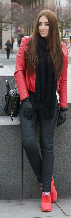 Red running shoes w/ matching leather jacket, pink lips, chestlength brown hair, black scarf & pants