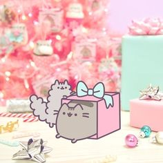 Trying to wrap presents but can't stop playing in the boxes #PusheenAtClaires