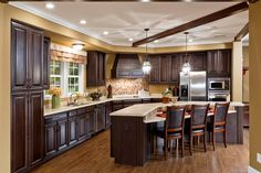 WOW! Everything from the dark wood to the center island to the wood floors make this kitchen one to remember.
