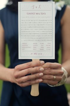 Clever idea for a wedding program fan at an outdoor wedding...a word search on the reverse for your guests!