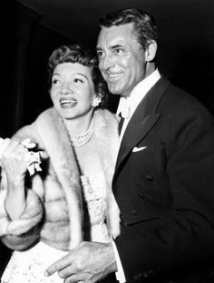 Claudette Colbert and Cary Grant at the wedding of Carol Lee Ladd and Richard Anderson. Photographed by Nat Dillinger in California, 1955