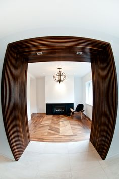 Delicieux A Custom Made Alcove Integrating Two Invisible Doors (powder And Closet  Doors) With Surrounding Wall Panels. The Wood Is Oiled Solid Black American  Walnut.