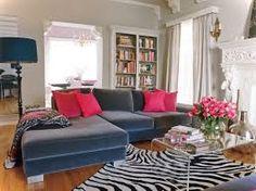 Living Room Ideas Marvelous Velvet Blue Couch On Zebras Carpet Feat Built In Bookshelves As Well Pink Cushion Decorate Gray