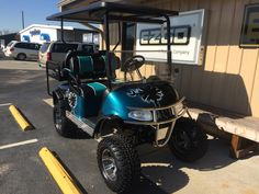 """The teal colored """"Palmetto"""" cart from our """"Palmetto"""" series golf carts"""