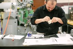 Limbitless Solutions Director of Production, Dominique, at work on 3D printed bionics
