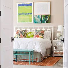 Bedrooms should be restful, but that doesn't mean they should be boring. And this bedroom manages to do just that, thanks to color in all the right places -- on the accent pillows, the rug, even a painted bench.