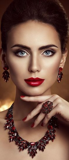 TOP 14 Fashion Accessories 6. Silver necklace with red ruby matching red nails and red lipstick. All with black bracelets.
