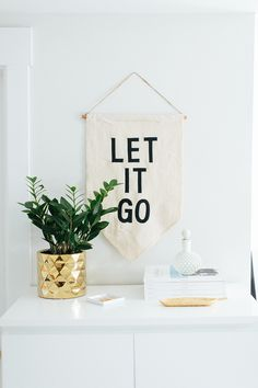 The Everygirl Cofounders' Chicago Home and Office Tour #theeverygirl | Let It Go banner | Schoolhouse Electric