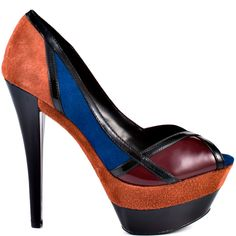 Strike the match with this Jessica Simpson style and watch your outfit go from drab to on fire!  Match features a color blocked suede upper of blue, burnt red and patent with a 1 1/2 inch double stacked platform.  This ravishing multi colored style showcases a 5 1/2 inch heel height.