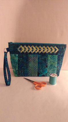 """June 9, 2015... Got another bag done today. Used Atkinson Designs Zippy Strippy basic pattern, size large. I made a custom top piece (both sides) using the Double Diamond ruler by Kim Templin. I also added a handle with D-Ring application. Batiks worked their usual magic on this pretty bag. 7"""" high by 11-1/2"""" wide."""