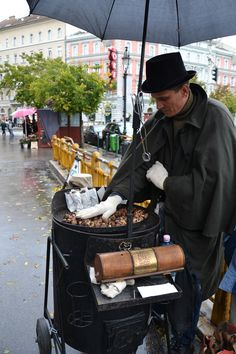 Man selling roasted chestnuts on Octogon Square. No winter without it! Budapest, Hungary.