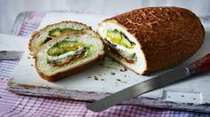 Roasted vegetable picnic loaf - A bread loaf packed with sweet roasted vegetables, mozzarella and fresh basil to make a delicious addition to a picnic, or serve in slices at home with crisp croutons for contrast