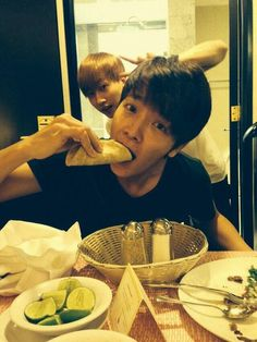 donghae about to take a bite of his taco with eunhyuk in the back xD #donghae #omnomnom   via donghae's instagram