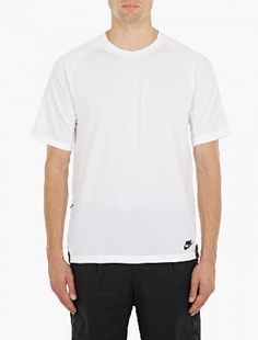 Nike White Cotton Logo T-Shirt The Nike Cotton Logo T-Shirt for AW16, seen here in white. - - - Crafted from premium cotton and cut to offer a relaxed fit, this t-shirt from Nike features contrasting black panels, a secure zip pock http://www.MightGet.com/january-2017-13/nike-white-cotton-logo-t-shirt.asp