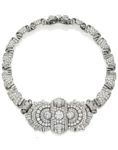 AN ART DÉCO DIAMOND NECKLACE. Centring three pavé-set diamond panels, each enhanced by a larger old-cut diamond, to the detachable graduated necklace and bow-shaped clasp, set with circular and baguette-cut diamonds, 1920s, mounted in gold, front panels d