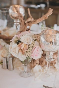 Like the driftwood and the flowers in antique glasses. I have those :). Or put some succulents with it. And the moss table runner.