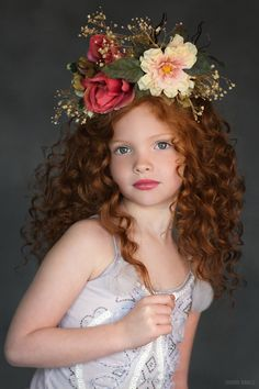 Sandra Bianco Photography specializes in photography of children. Pin comes from Sandra Bianco's own website. © Sandra Bianco Photography, tutudumonde studio sessions, February 2015, girl with long, wavy, auburn hair, hair decorated with silk flowers
