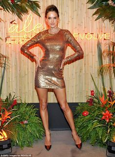Golden girl: Alessandra Ambrosio dazzled in gold as she debuts new collection at Revolve Social Club in West Hollywood