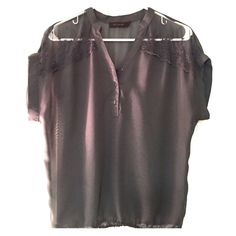 Gray sheer short-sleeved top This sheer top has a button down front containing three buttons. The shoulder area is a see-through lace covering- about 5 inches from shoulder to chest area. Elastic waistline. The Limited Tops Blouses