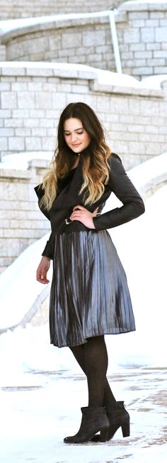 Loving this dressy winter look! | Fashion blogger Mash Elle styles a @DynamiteStyle pleated skirt with a velvet bodysuit and black booties.