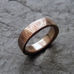 Bronze bark rustic w Bronze bark rustic wedding ring, textured rustic ring, alternative weding band, made to order in your size. $76.00, via Etsy.
