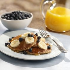 Whole Grain Pancakes with Fresh Fruit: Fluffy whole grain pancakes drizzled with honey and topped with fresh fruit