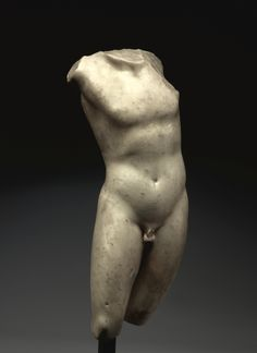 A MARBLE TORSO OF A YOUTH, ROMAN IMPERIAL, CIRCA 1ST CENTURY A.D