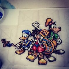 Kingdom Hearts tribute phase 3 done, Donald in there now. Still not sure if the whole thing is done yet because I have a few ideas for a background. Customized his staff in hand by piecing it in the after salvaging it from a different sprite. Think I'm getting good a Frankensteining sprites now. None of the three of these guys have sprites out there in these forms, close but not with the weapons. This piece was completely me, not a commission so it will be for sale if anyone is interested…