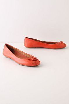 orange-y flats with flower cut-out, knotted leather toes - cute! <> (#anthropologie, orange, color, shoes)
