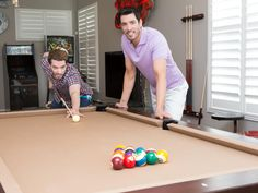 Property Brothers Drew and Jonathan playing pool on their Brunswick Treviso pool table
