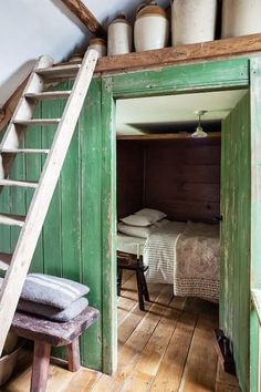 Painted wooden walls with Green. House in Carmarthen, Uniter Kingdom.