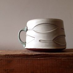 http://www.sarahpikepottery.com/pots/cups-and-mugs/