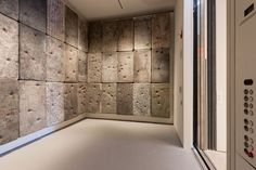 Elevator Installation by Guillermo Kuitca... Wall-hung mattresses painted with maps