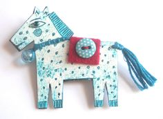 One of my illustrated horse brooches.