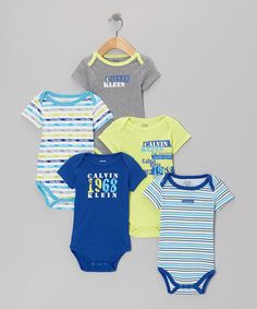 Make sure Baby's wardrobe is working a full-time schedule with this stunning set of bodysuits. Five similarly themed but distinct styles provide a consistent variety of darling looks. With lap necks and snaps on each, cozy comfort is featured across the board. Includes five bodysuits58% cotton / 42% polyesterMachine wash...