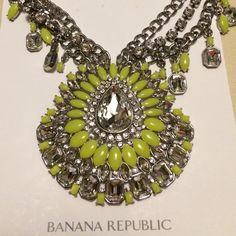 """Banana Republic Statement Necklace This bold necklace has silver colored chains with lime green and clear stones. Adjustable clasp closure. Approx. 12-1/2"""" long (pendant is approx. 3-1/2"""" wide). Banana Republic Jewelry Necklaces"""