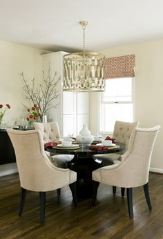 Beautiful chairs - love the soft beige against the black table.