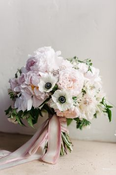 Camellia Floral Design Melanie Duerkopp Photography - Bridal bouquet with blush pink peonies, blushing bride protea, panda anemones with jasmine