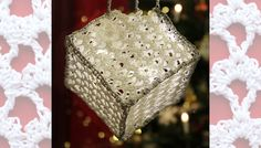 Free pattern for lace crochet cube decoration. Use LED lights in the hanging decoration. Written pattern and crochet chart.