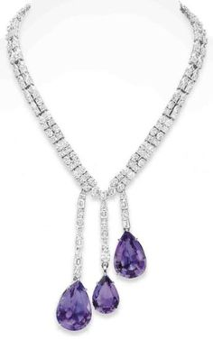 AN AMETHYST AND DIAMOND NECKLACE  Suspending a staggered tassel of three pear-shaped amethysts, each from a baguette-cut, pear-shaped and oval-cut diamond chain, to the two-row diamond neckchain of similar design, mounted in 18k white gold, 16¼ ins.   PROPERTY OF A LADY Christies