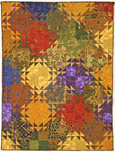 Lost in Singapore - I love this quilt by Jenny Bowker and would love to make similar with my sarong/Batik collection.