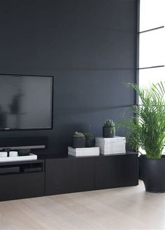 Simple Living Room Ideas Find inspiration for your home with our collection of over 50 simple living room ideas for […] Dark Living Rooms, Simple Living Room, Living Room Tv, Living Room Interior, Home And Living, Mid-century Modern, Piece A Vivre, Black Walls, Living Room Furniture
