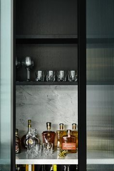 Black on black: A sleek and dramatic home tour. Hidden bar in kitchen, stylish home bar Home Bar Cabinet, Drinks Cabinet, Bar Cabinets For Home, Chiaroscuro, Reeded Glass, Timber Staircase, Interior Design Awards, Interior Ideas, Interior Styling