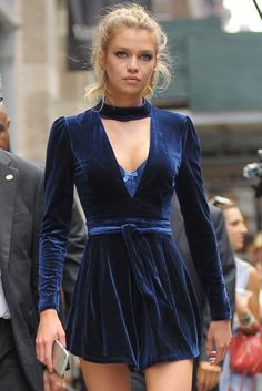 Stella Maxwell wears a blue velvet playsuit in New York.