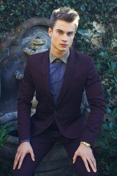 Deep purple suit perfectly compliments The Cheshire Cat style.